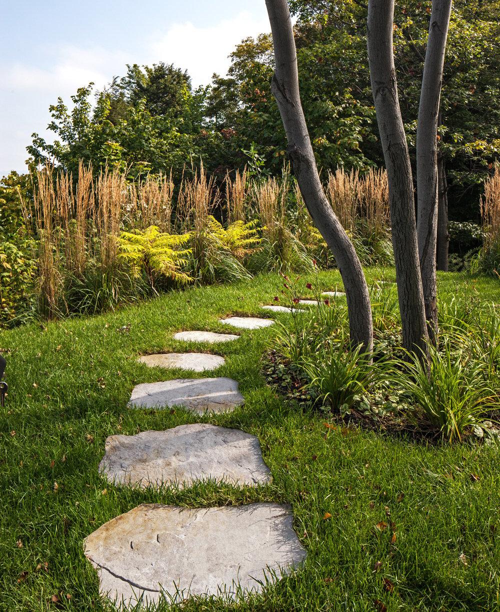 Maya concrete stone walkway through the backyard.