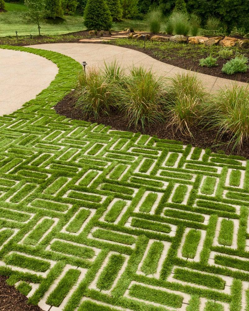 Eco-friendly permeable driveway designed with our Aquastorm paver.