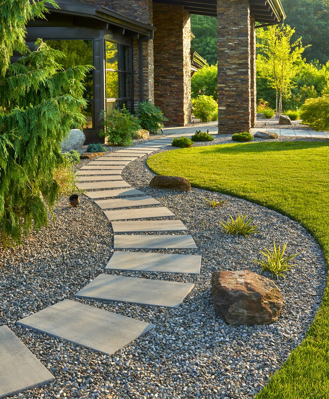 Blu Grande Smooth slab walkway from the front door to the backyard.
