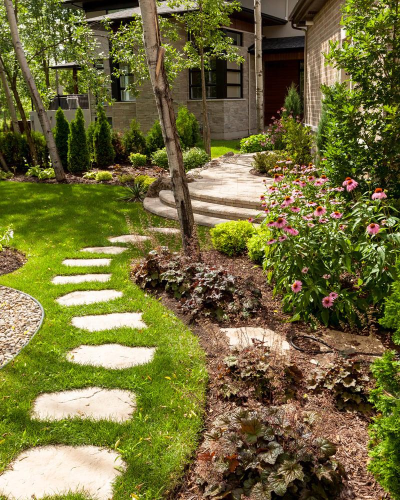Maya concrete stone garden walkway leading to the backyard patio.