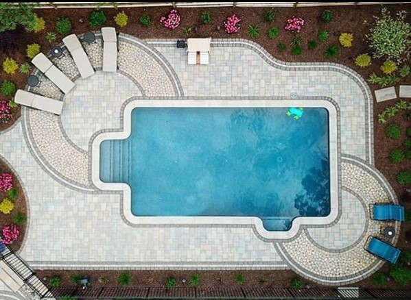 Traditional poolside backyard patio featuring three of our pavers.